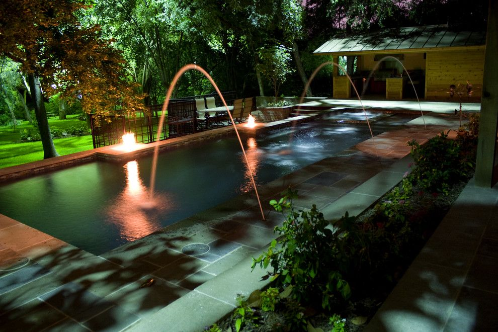 Aquaterra for a Eclectic Pool with a Firepit and Fire Features by Aquaterra Outdoors