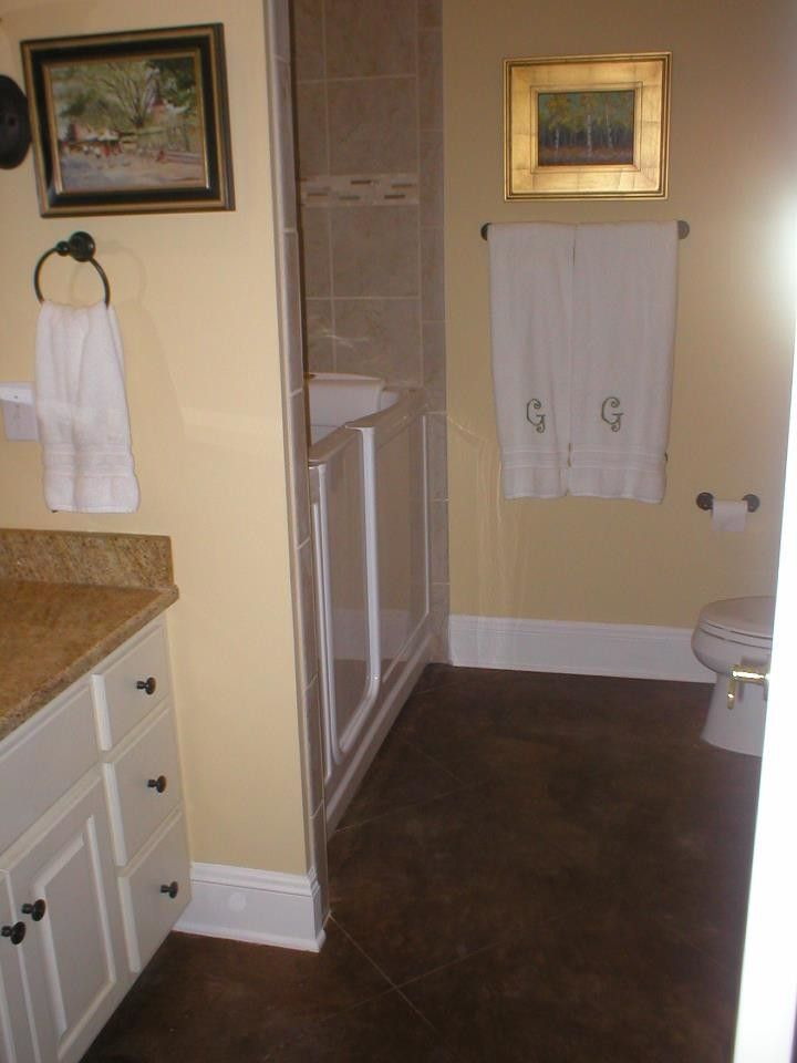 Ashford Homes for a Traditional Bathroom with a Yellow Wall and Our Work by Ashford Homes