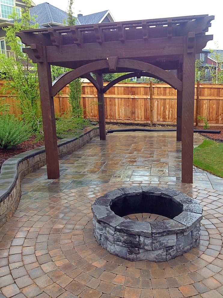 Aspen Contracting for a Traditional Landscape with a Covered Patio and Pergolas by Blue Aspen Contracting