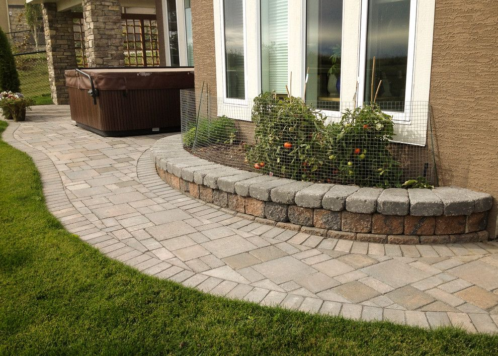 Aspen Contracting for a Traditional Landscape with a Landscape and Stone Patio and Planter by Blue Aspen Contracting