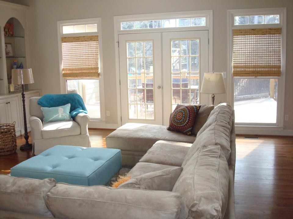 Atlanta Homes and Lifestyles for a Traditional Family Room with a Blue Ottoman and the Q Home by Rachel Greathouse