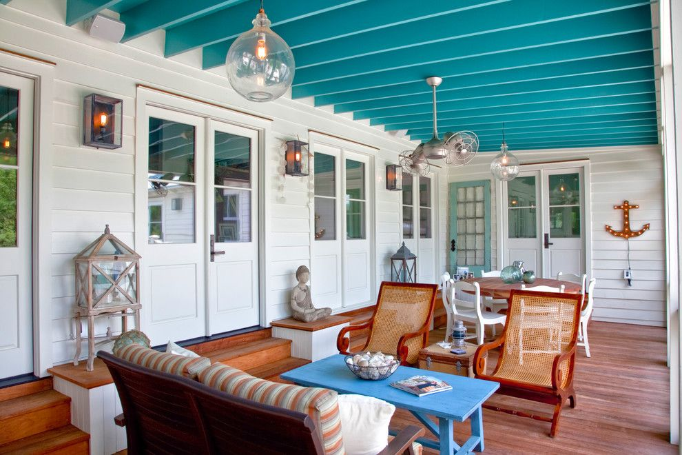 Atlas Roofing for a Beach Style Porch with a Ceiling Fan and Exterior Photography by Patrick Brickman