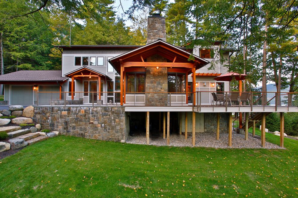 Atlas Roofing for a Rustic Exterior with a Stone Fireplace and Bolton Landing Modern Cabin by Teakwood Builders, Inc.