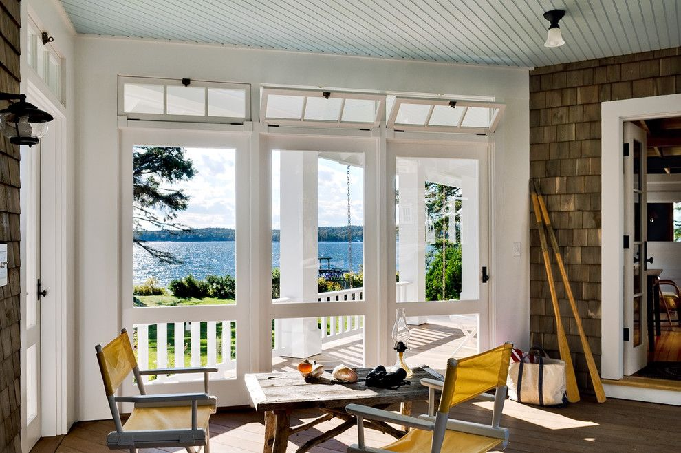 Atrium Windows and Doors for a Beach Style Porch with a Wood Ceiling and Three Season Porch by Whitten Architects