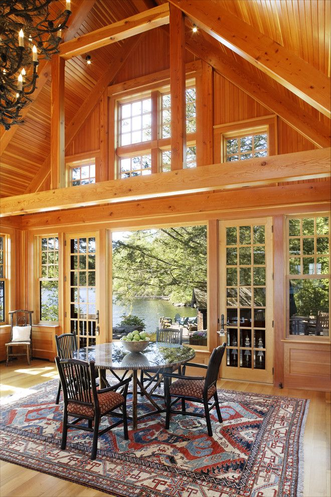 Atrium Windows and Doors for a Rustic Dining Room with a Indoor Outdoor and Woodland Point Great Room by Carl Vernlund