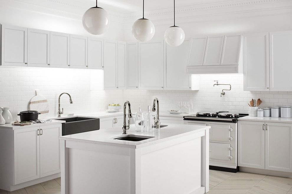 Atwal Eye Care for a Traditional Kitchen with a Herringbone Pattern and Carefully Curated Kitchen by Kohler