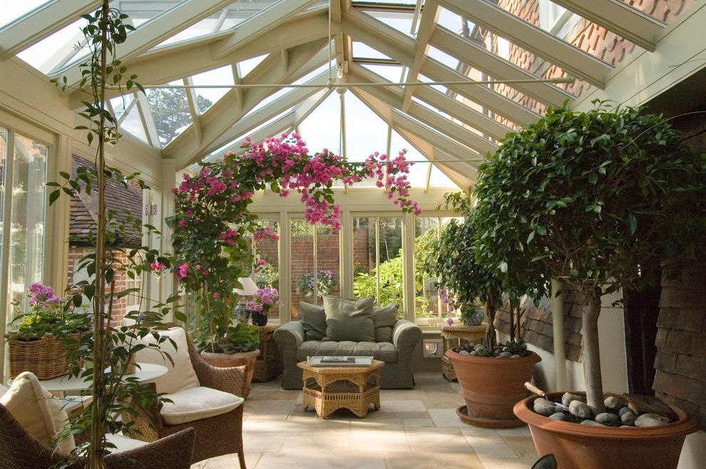 Avalon West Chelsea for a Traditional Sunroom with a Stone Floor and a Conservatory for Plants and People by Town and Country Conservatories