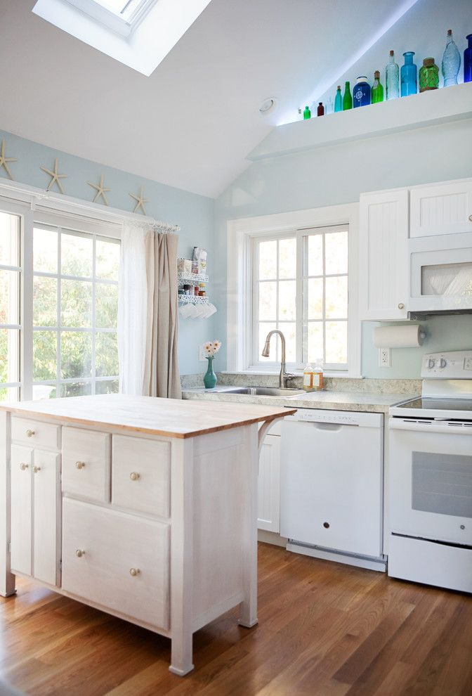 Avanti Furniture for a Beach Style Kitchen with a Wood Countertop and Chatham Addition by Patriot Builders Inc