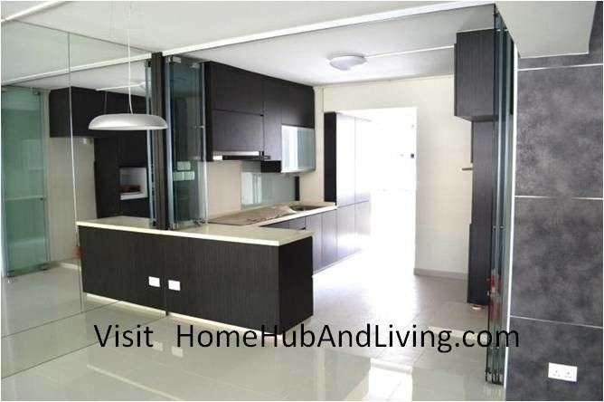 Axia Home Loans for a Contemporary Spaces with a Car Porch and Stylish Designed Modern Kitchen (Counter Top Island) with Frameless Door System by Home Hub and Living