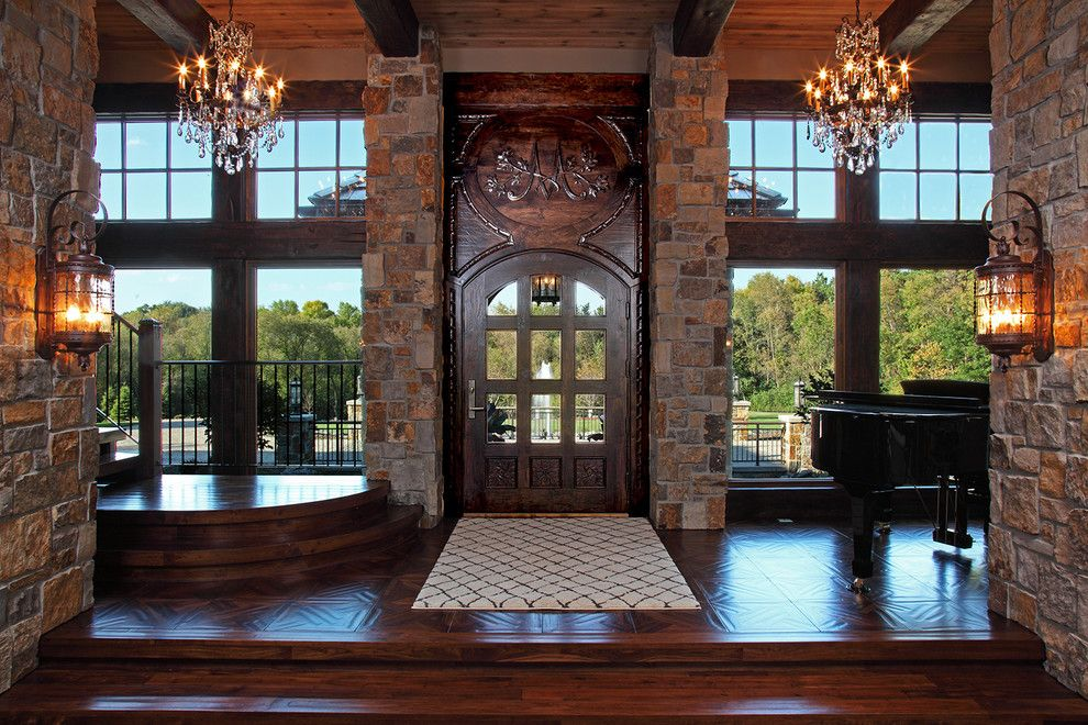 Baby Grand Piano Dimensions for a Rustic Entry with a Crystal Chandelier and Old World Deer Lodge Estate by James Mcneal Architecture and Design
