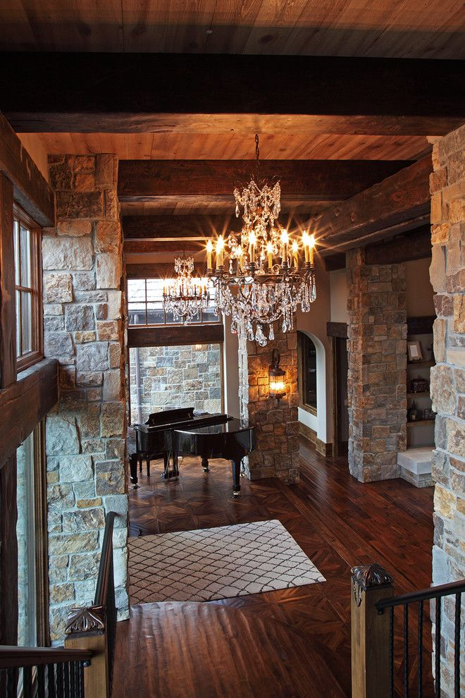 Baby Grand Piano Dimensions for a Rustic Entry with a Interior Exposed Stone Wall and Old World Deer Lodge Estate by James Mcneal Architecture and Design