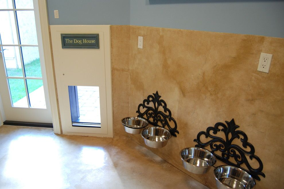 Baby Wiener Dogs for a Mediterranean Laundry Room with a Door and South Jacksonville by Cote Renard Architecture