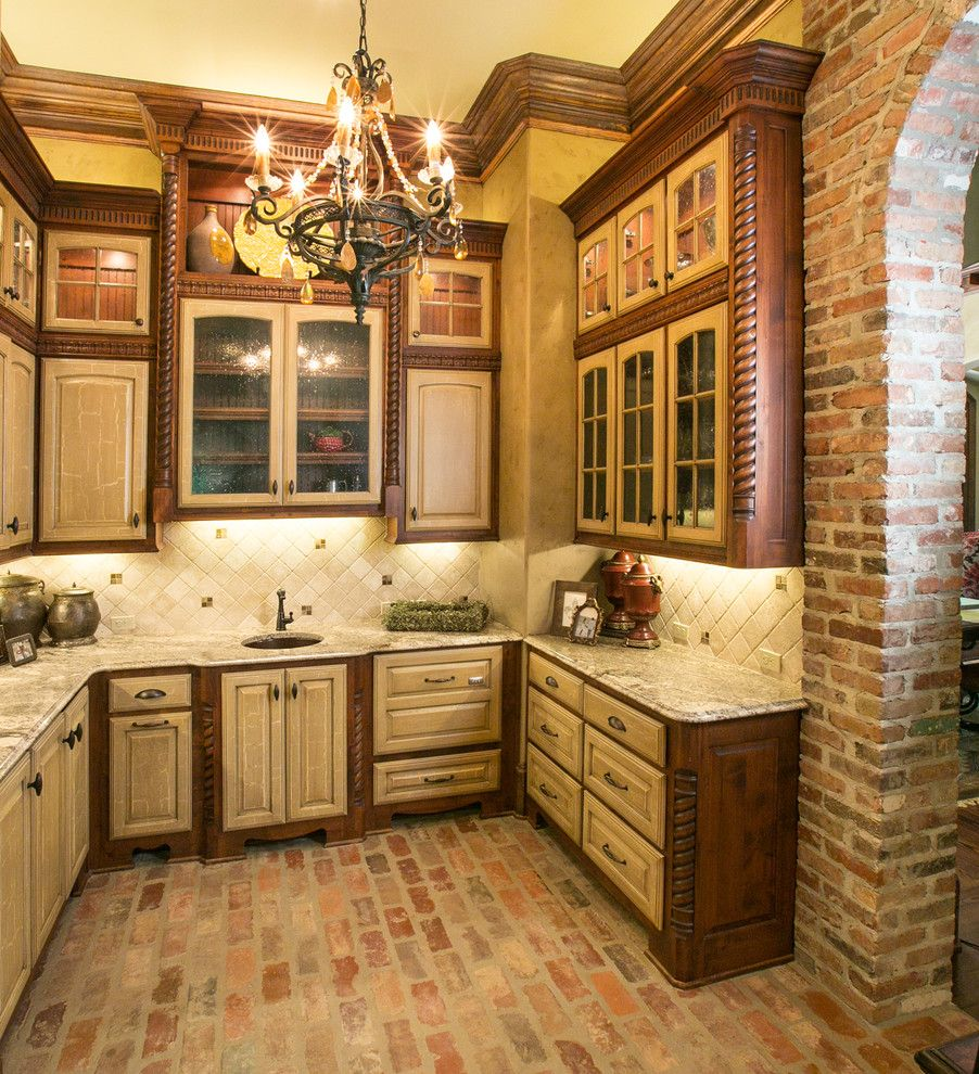Back Page San Francisco for a Mediterranean Kitchen with a Chandelier and Butler's Pantry by Terry M. Elston, Builder