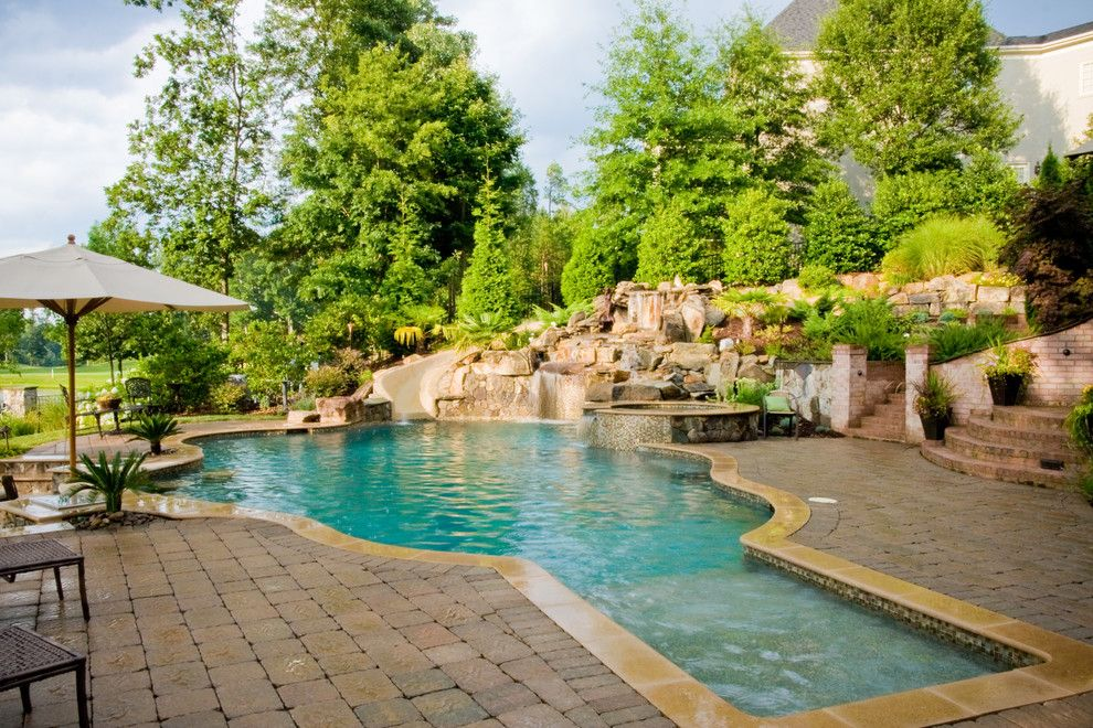 Ballantyne Spa for a Tropical Spaces with a Boulder Waterfall and Ballantyne Tropical Oasis by Coogan's Landscape Design