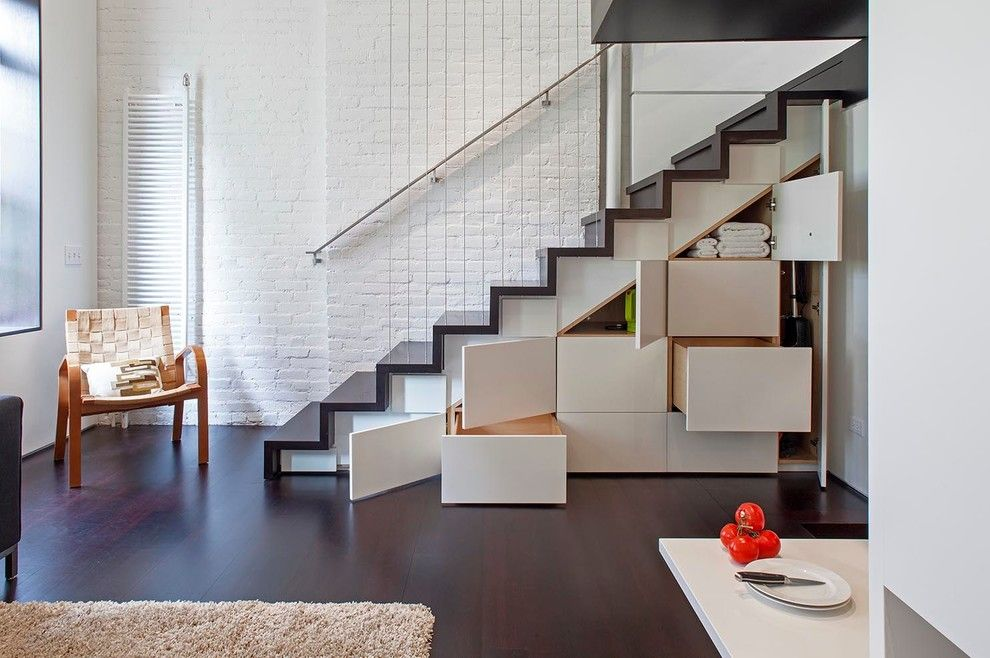 Baluster Spacing for a Industrial Staircase with a Strap Side Chair and Manhattan Micro Loft by Specht Architects