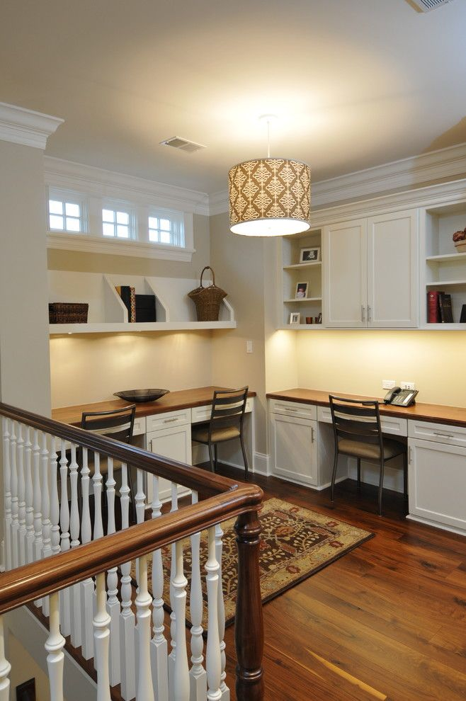 Baluster Spacing for a Traditional Home Office with a Open Shelves and Revere House by Designstorms Llc