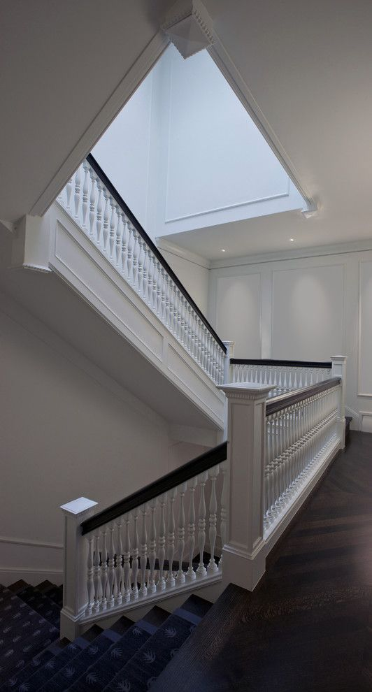 Baluster Spacing for a Traditional Staircase with a Chevron Floor and Grand Stair by dSPACE Studio Ltd, AIA