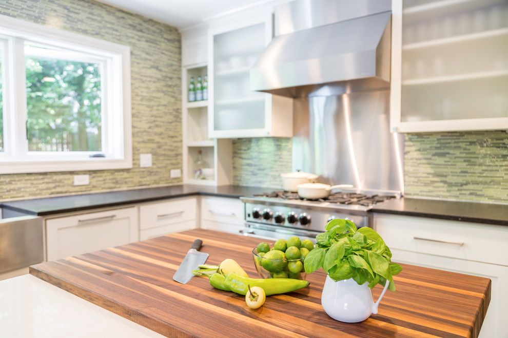 Bamboo Cutting Board Care for a Transitional Spaces with a Sliding Barn Doors and Kitchen with Industrial Touches by Design Harmony