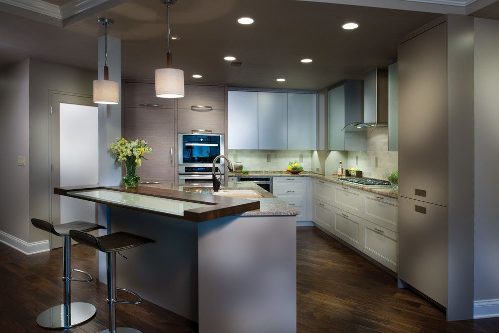 Bar Method Oakland for a Modern Kitchen with a Dark Wood Floor and Thermador by Thermador Home Appliances