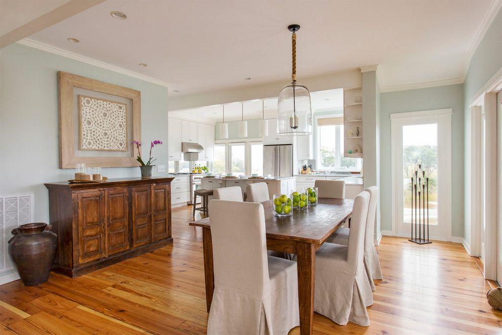 Barstol for a Beach Style Dining Room with a Hanging Pendants and Marsh Front Home by Amy Trowman Design