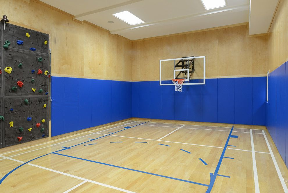 Basketball Court Layout for a Contemporary Home Gym with a Light Wood Walls and Basketball Court & Bar by Rr Builders, Llc