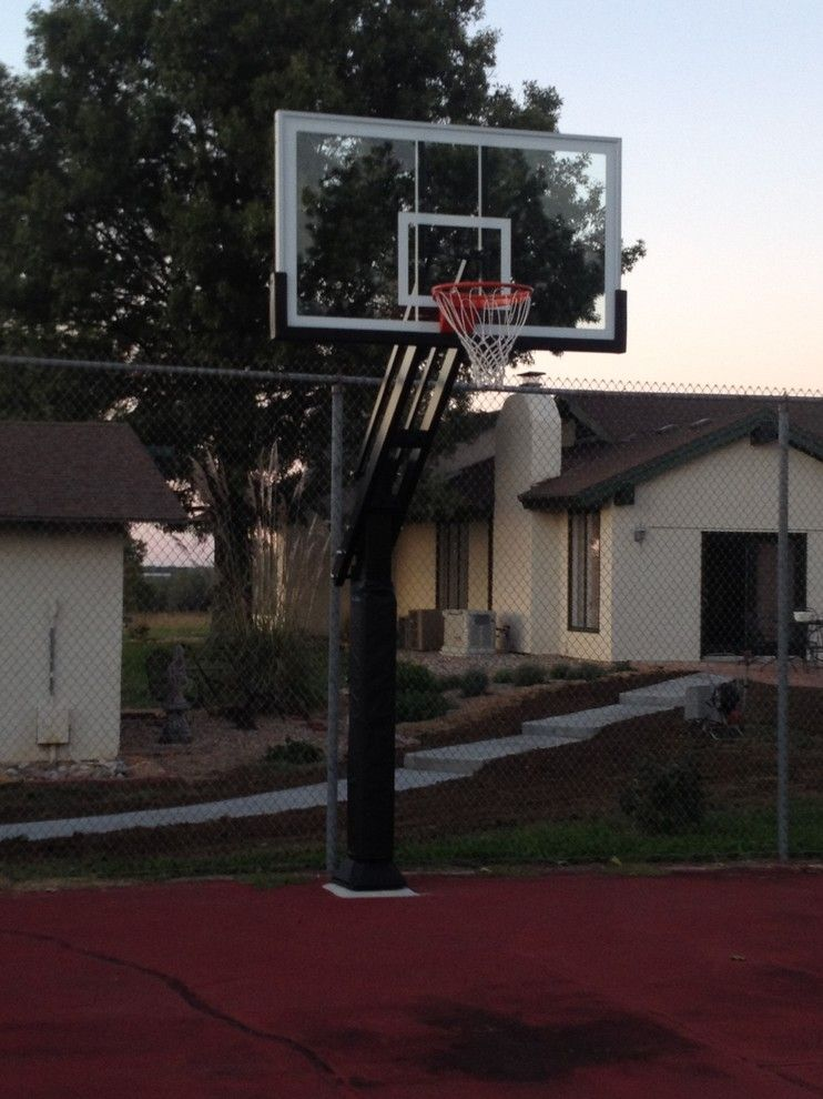 Basketball Court Measurements for a Traditional Landscape with a Driveway Basketball Hoop and Paul F's Pro Dunk Platinum Basketball System on a 58x34 in Lawrence, KS by Pro Dunk Hoops