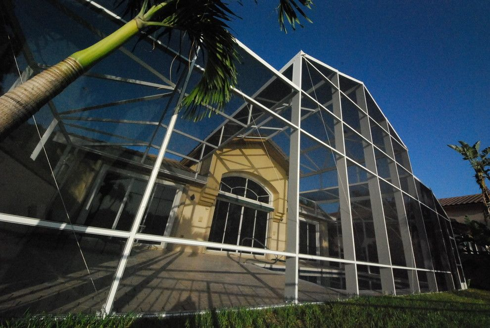 Batting Cages Miami for a Tropical Pool with a Bird Cage and Residential Pool Enclosure by Coastal Screen and Rail