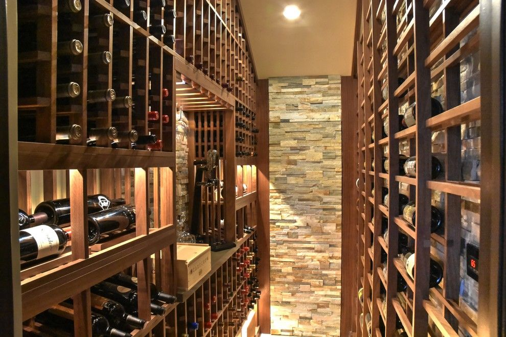 Beach Cottages San Diego for a Mediterranean Wine Cellar with a Floor to Ceiling Wine Racks and Del Mar San Diego Small Custom Wine Cellar Walk in with Hidden Door Beer Storage by Vintage Cellars