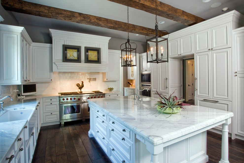 Bean Group Nh for a Traditional Kitchen with a Kitchen Tv and Raised Panel, White Cabinet Kitchen with Oversize Island, Hand Hewn Ceiling Beam by Orren Pickell Building Group