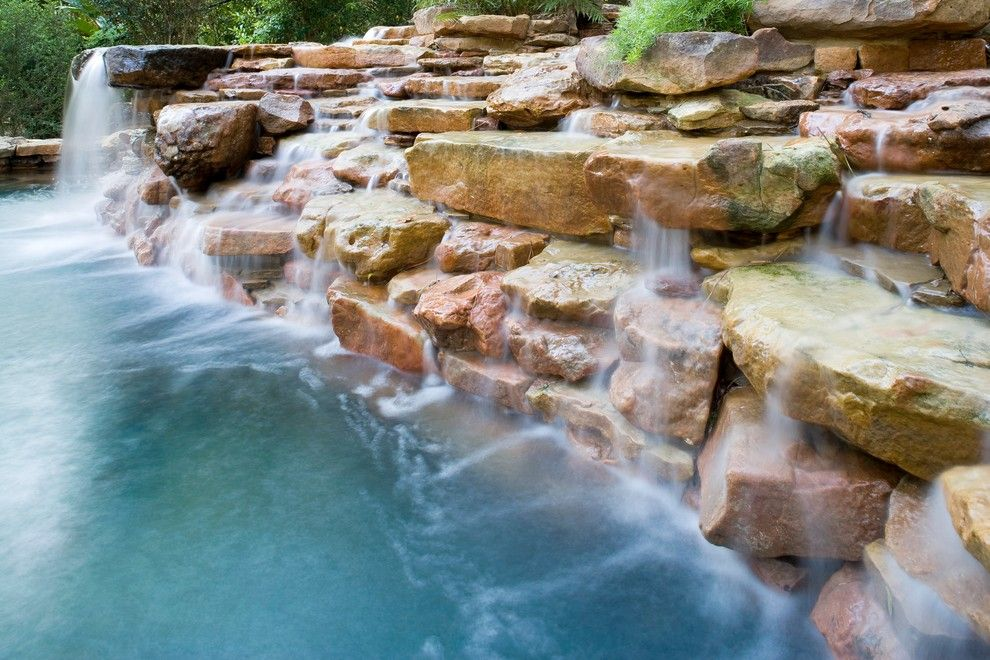 Beazer Homes Houston for a Eclectic Pool with a Blue Plaster and Natural Waterfall & Swimming Pool by Exterior Worlds Landscaping & Design