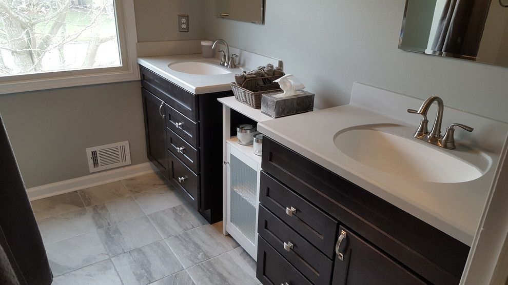 Bell Tower Hotel Ann Arbor for a Traditional Bathroom with a Cast Iron Bathtub and Ann Arbor Dual Vanity Guest Bath by Exemplar Carpentry & Home Repair