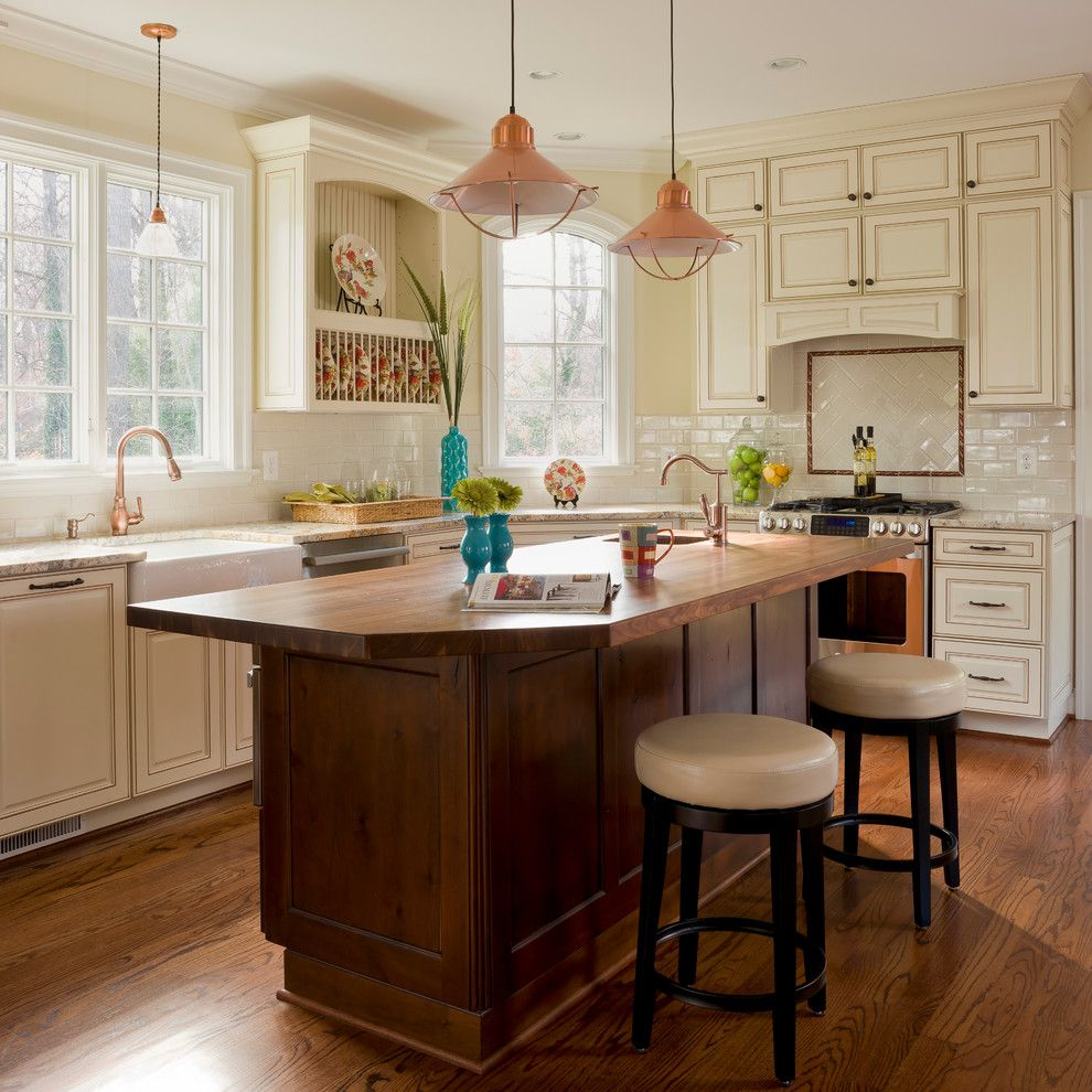 Benjamin Moore Whites for a Traditional Kitchen with a Wood Island Countertop and Williamsburg by Phoenix Builders, Inc.