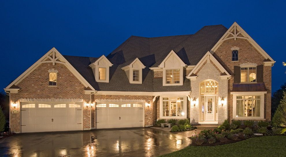 Best Buy Joliet Il for a Traditional Exterior with a Brick Wall and Elegant Traditional Home with English Pub by John Hall Custom Homes