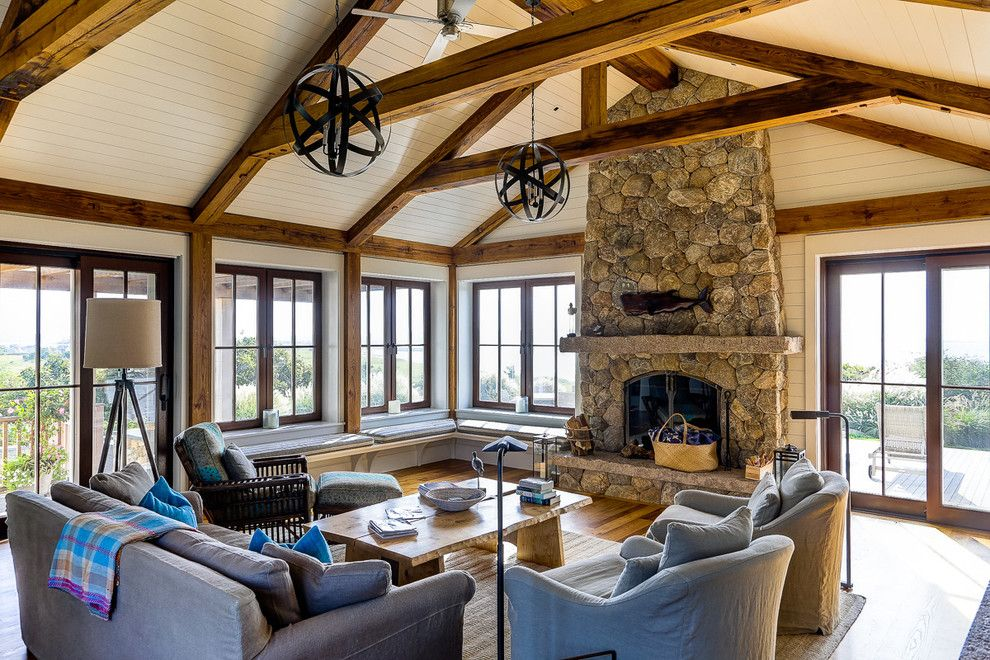 Beverly Fabrics for a Beach Style Living Room with a Coastal and Casual Beach Living Room with Exposed Wood Barn Beams by Roam Design, Llc