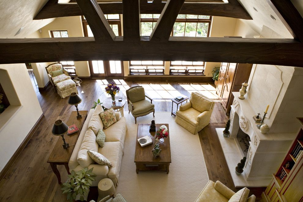 Bif Furniture for a Traditional Family Room with a Exposed Beams and Living Room by Claudio Ortiz Design Group, Inc.