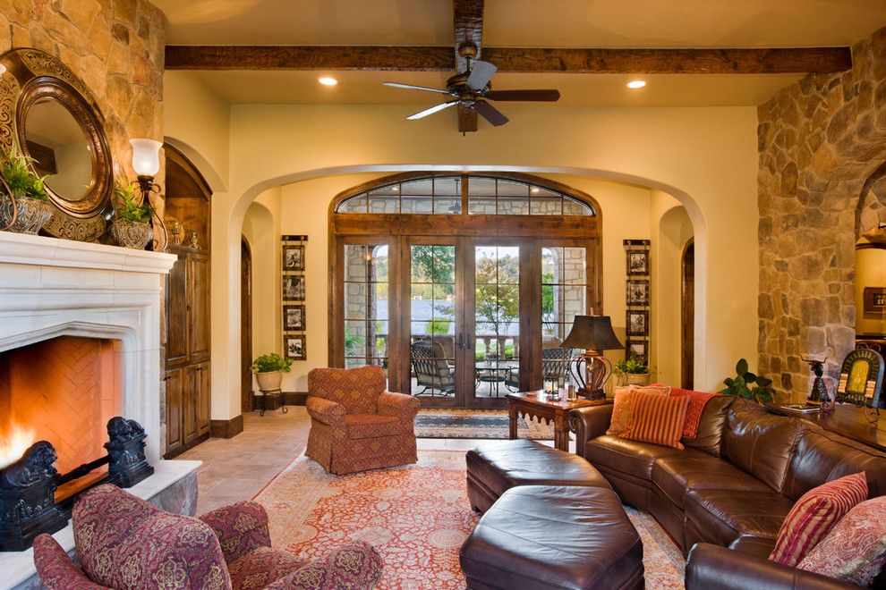 Binswanger Glass Austin for a Traditional Family Room with a Stone Wall and Lake Austin by Geschke Group Architecture