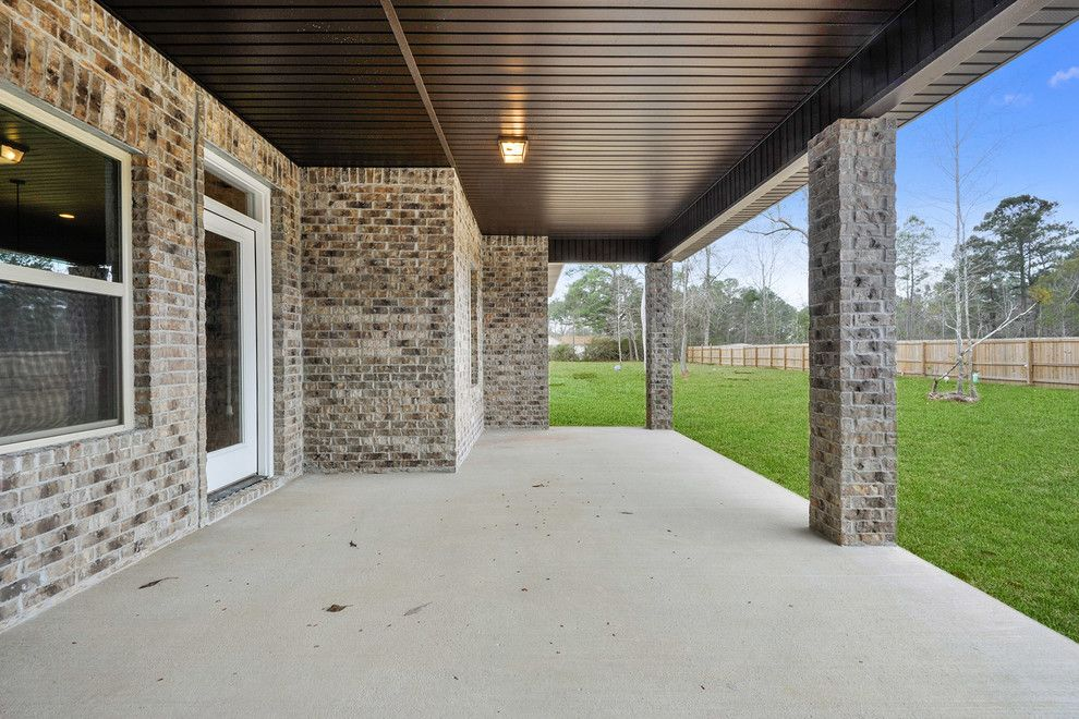 Boral Bricks for a Contemporary Exterior with a Krestmark Windows and the Allen by Elliott Homes Llc