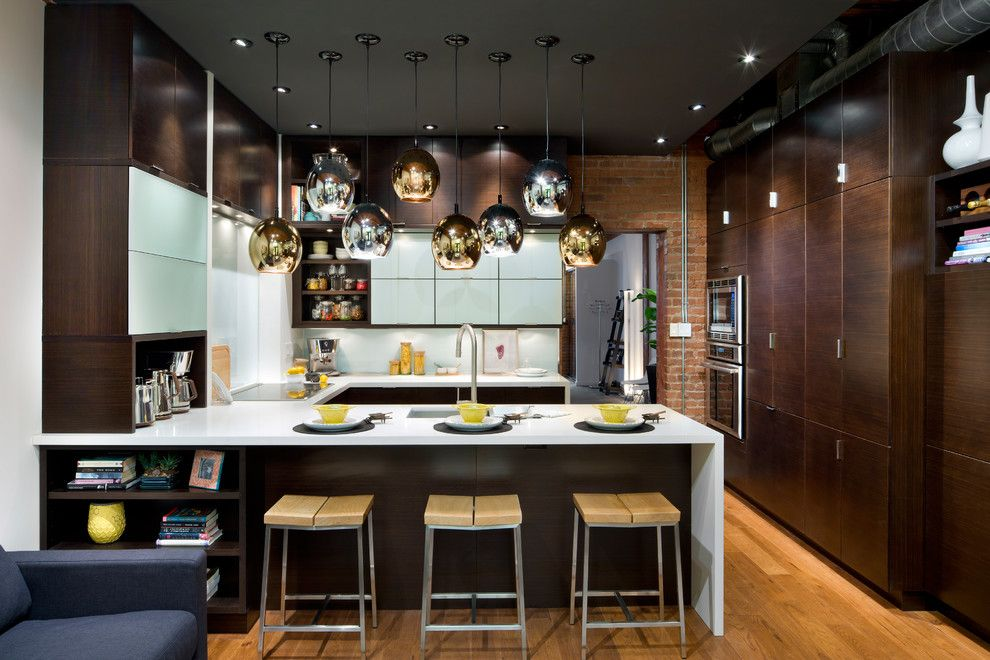 Boral Bricks for a Modern Kitchen with a Waterfall Countertop and Thermador by Thermador Home Appliances