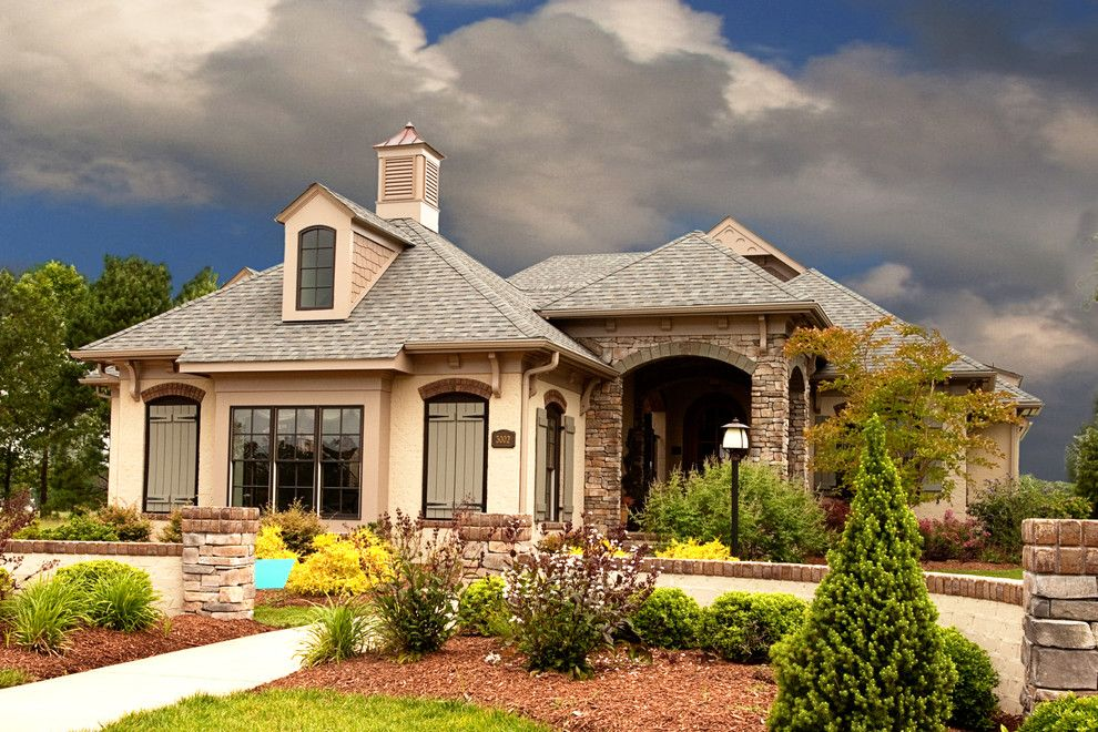 Boral Bricks for a Transitional Exterior with a Boral Brick Exterior and 2010 Southern Living Home of the Year by Interior Visions, Inc.