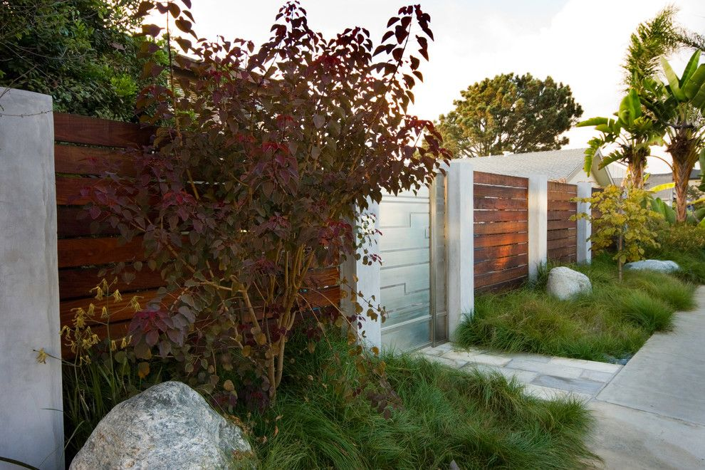 Boulder Lumber for a Modern Landscape with a Tall Grass and Serene Backyard by Hamilton Gray Design, Inc.