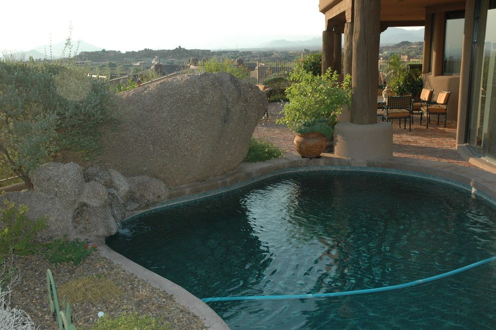 Boulders Golf for a Rustic Pool with a Elevator and Troon Scottsdale Pueblo Style Built Into the Boulders by Darling Residential Architecture and Design