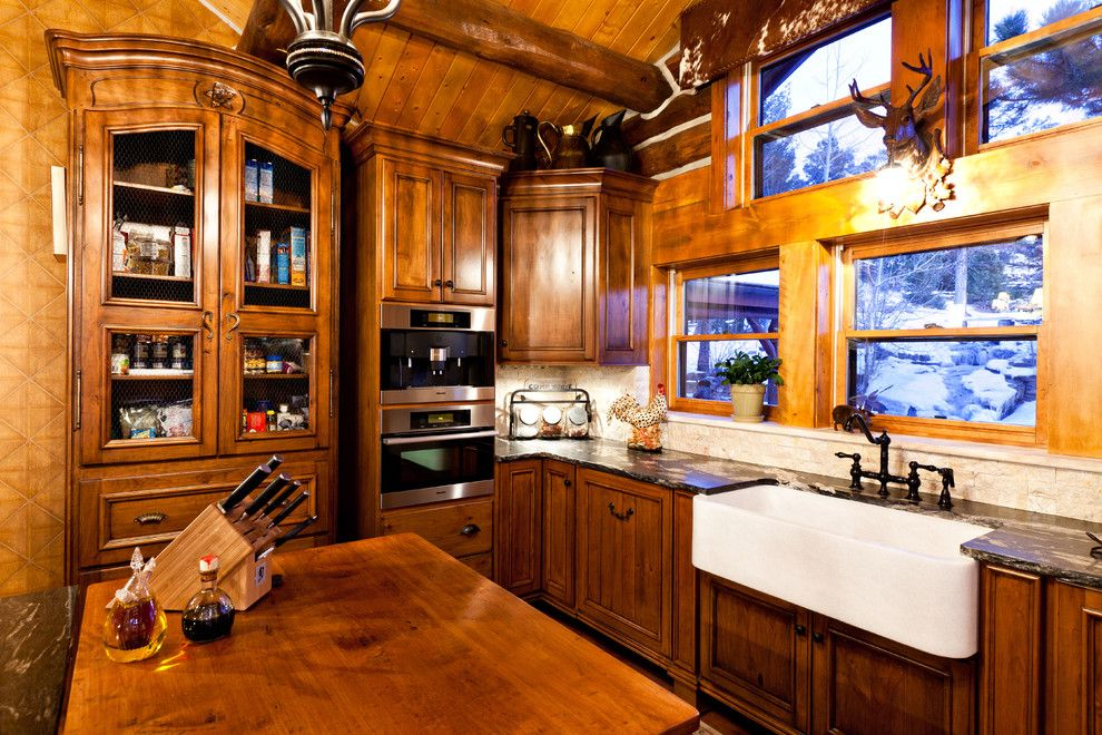 Bravos Pizza for a Rustic Kitchen with a French Country and Evergreen Log Home by Monica Durante Interiors, Inc