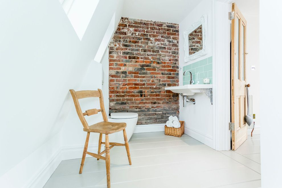 Brick Wall Waterfall for a Beach Style Bathroom with a Sloped Wall and Roof Top Extension / Loft Conversion Old Portsmouth by Westcott Construction Ltd