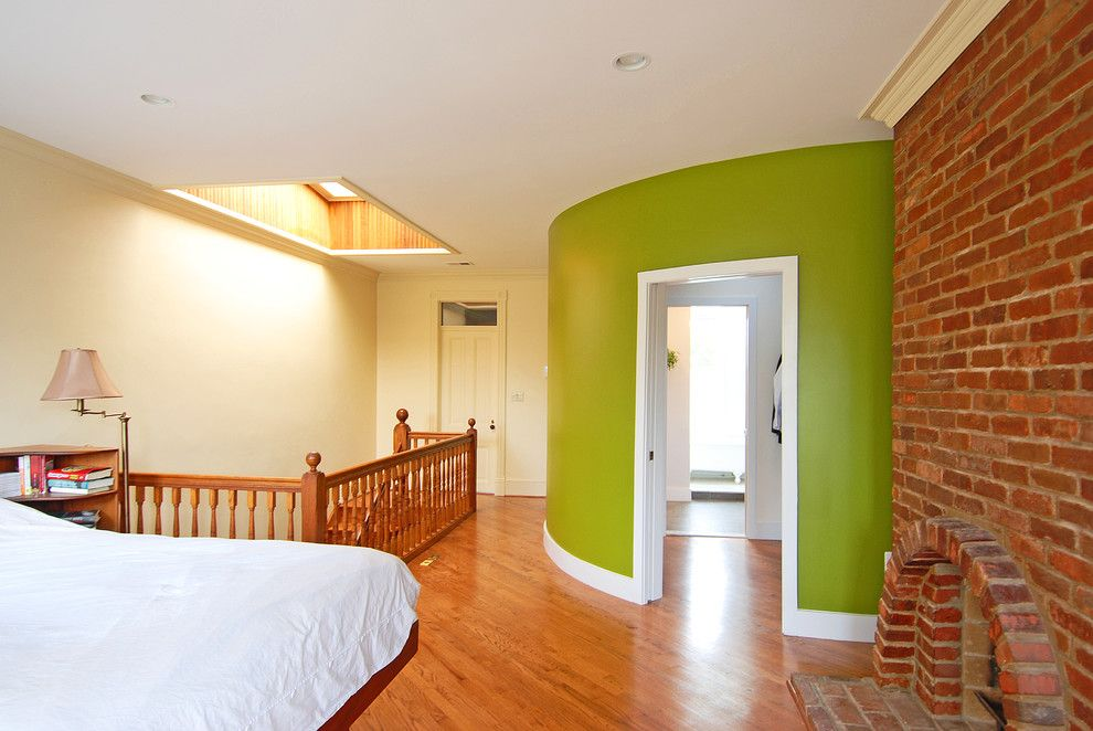 Brick Wall Waterfall for a Eclectic Bedroom with a Curved Wall and Capitol Hill Master Suite by Impact Remodeling and Construction