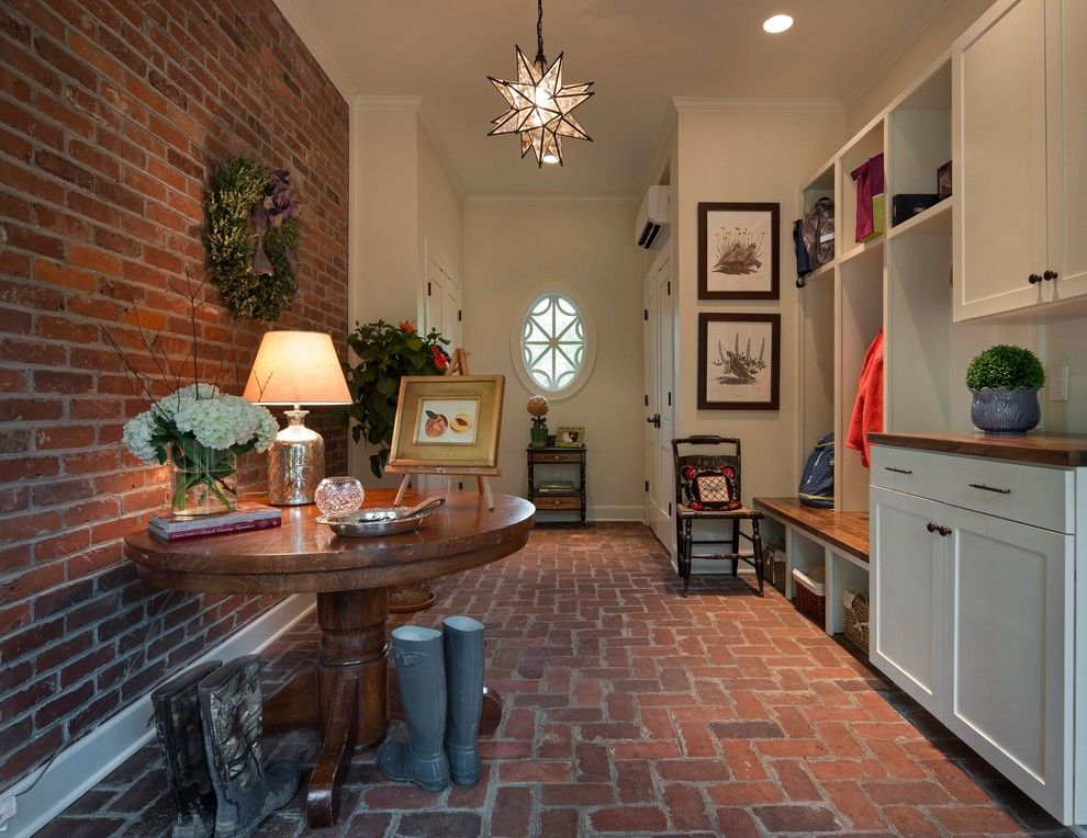 Brick Wall Waterfall for a Farmhouse Entry with a Built in Cabinets and the Elizabeth Project by Kbc   Kelley Building Company