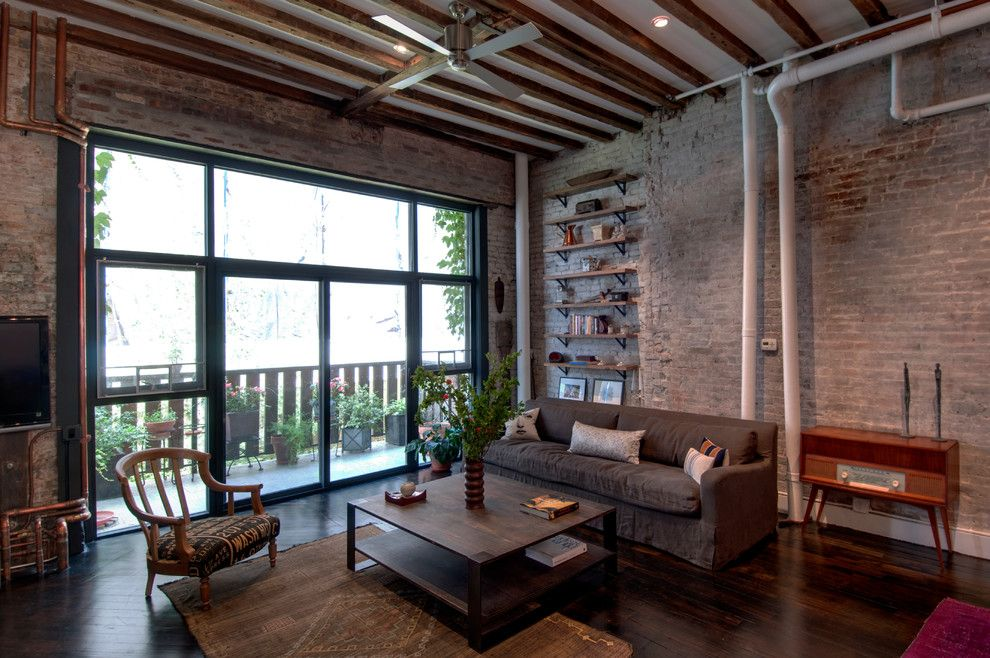 Brick Wall Waterfall for a Industrial Living Room with a Wood Shelves and Reiko Feng Shui Interior Design   Loft Renovation by Reiko Feng Shui Design