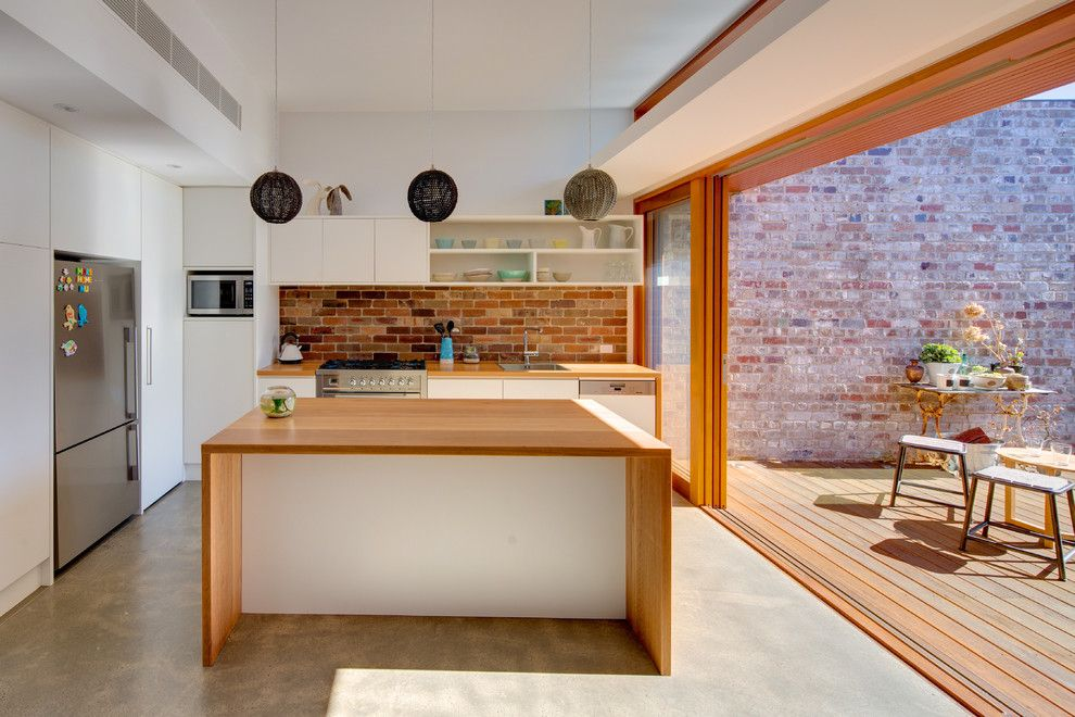 Brick Wall Waterfall for a Modern Kitchen with a Pocket Doors and Maroubra House by Angus Mackenzie Architect
