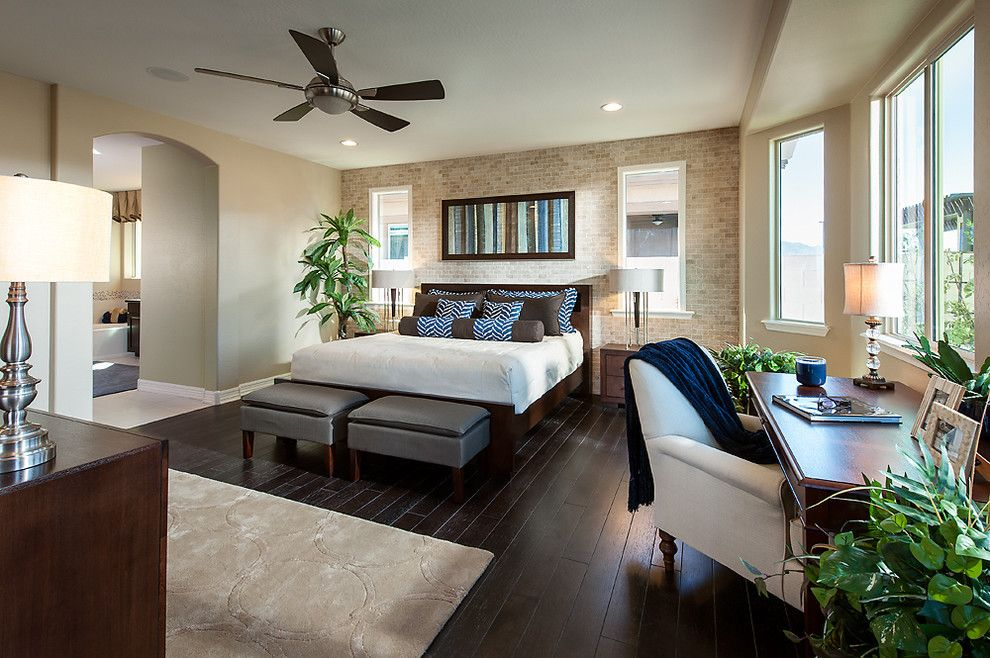 Brick Wall Waterfall for a Traditional Bedroom with a Ceiling Fan and Arch Crossing at Bridges at Gilbert by Maracay Homes Design Studio