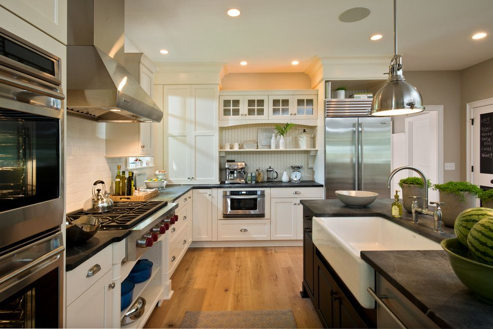 Brick Wall Waterfall for a Traditional Kitchen with a Black Countertop and 2013 Parade of Homes   Pinnacle Homes Winner   Best Kitchen by Columbia Cabinets