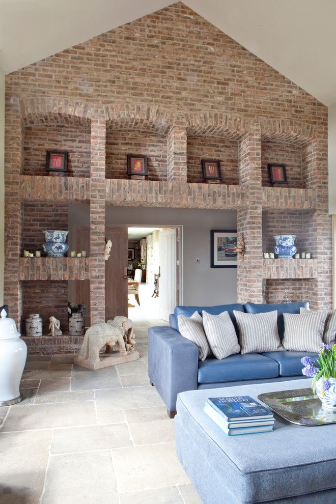 Brick Wall Waterfall for a Transitional Living Room with a Stone Elephants and the Grange by Carolyn Parker Interior Design Ltd.
